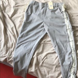Grey pants with white side